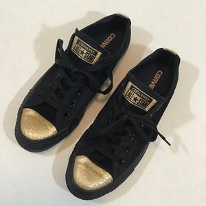 Black and Gold Converse.